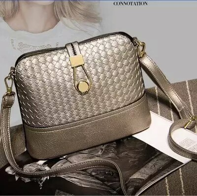 B016 IDR.152.000 MATERIAL PU SIZE L23XH19XW9CM WEIGHT 400GR COLOR SILVER