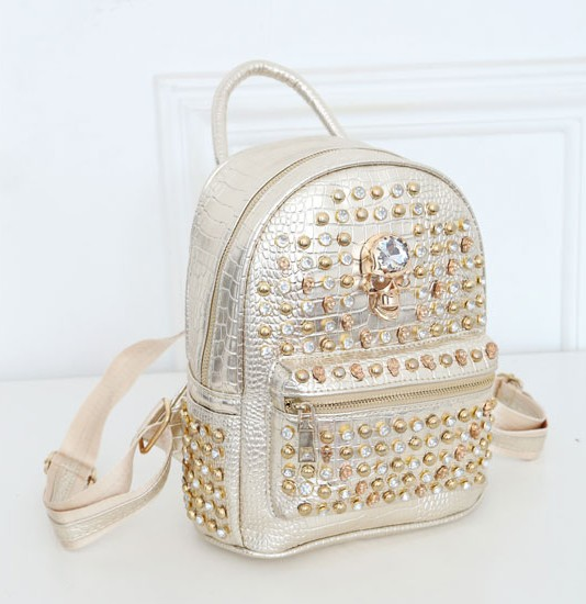 B917 IDR.185.000 MATERIAL PU SIZE L31XH24XW10CM WEIGHT 600GR COLOR GOLD.jpg